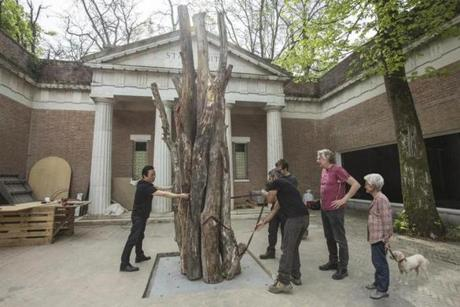 Joan Jonas (right) watched a team of workers placing pieces in the forecourt of the US Pavilion at the Venice Biennale.
